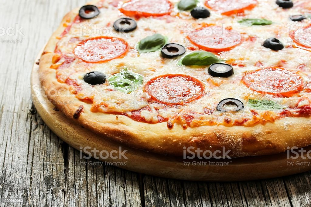 Homemade Pepperoni Pizza close up side view stock photo