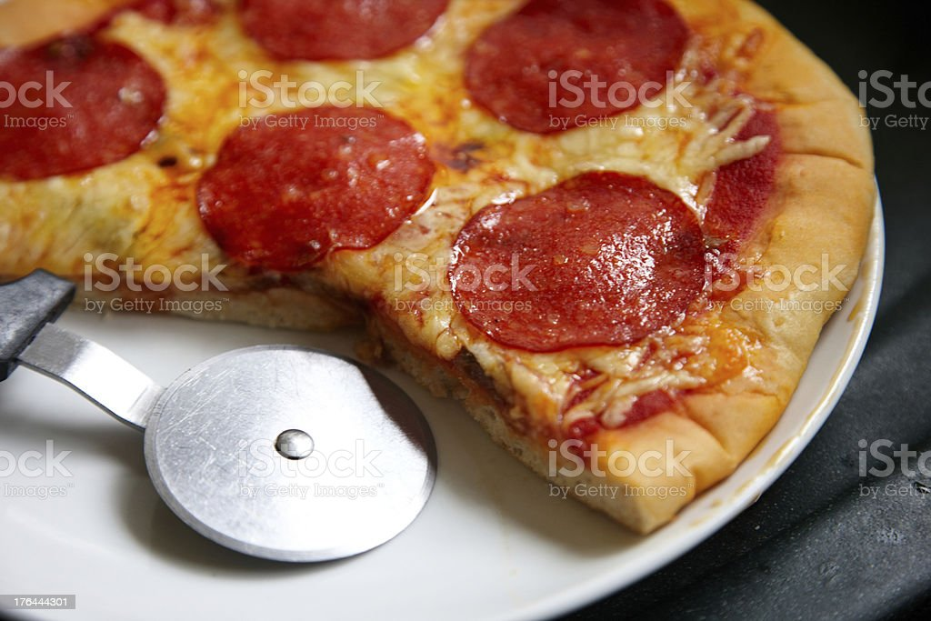 Homemade Pepperoni pizza with cutter stock photo