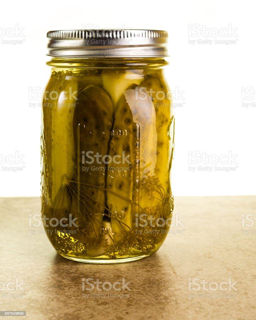 Homemade pickles in mason jars stock photo