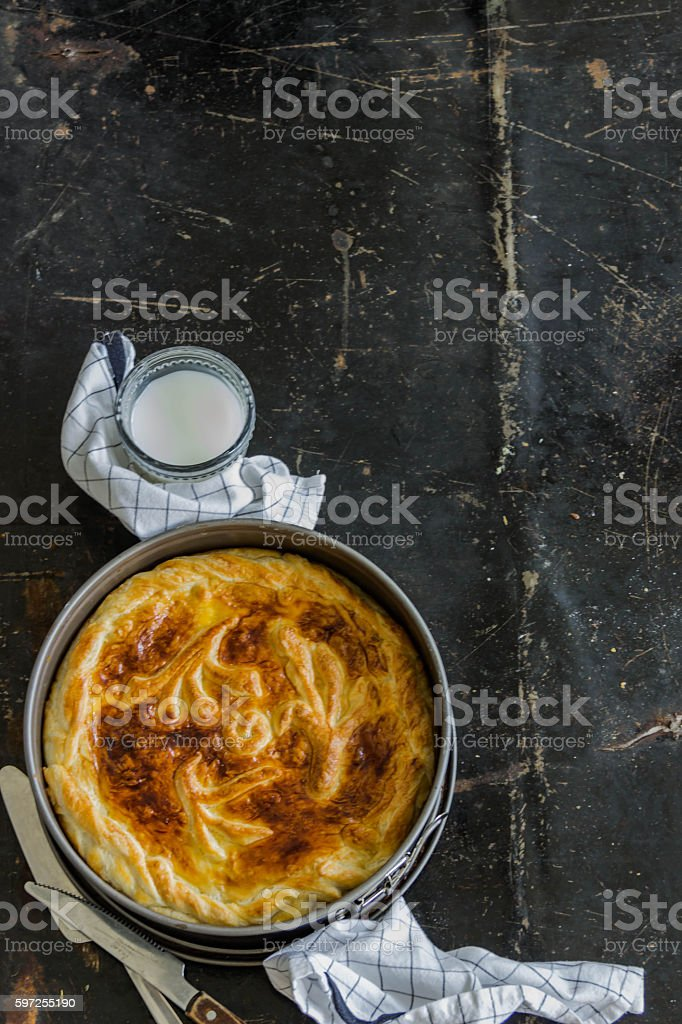 Homemade pie covered with apple. Copyspace stock photo