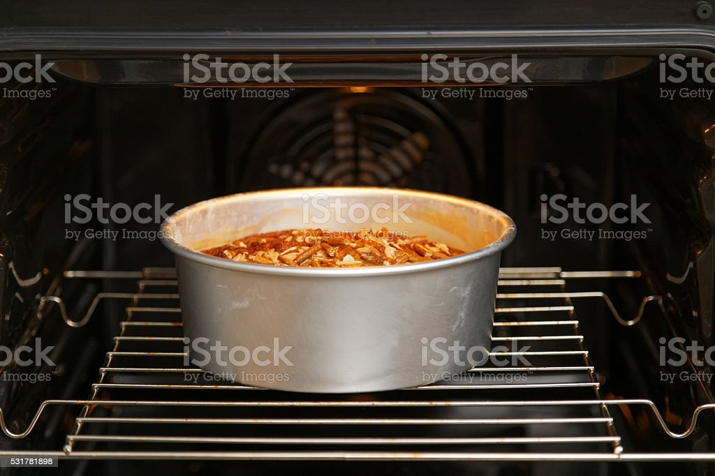 Homemade pie in open oven stock photo