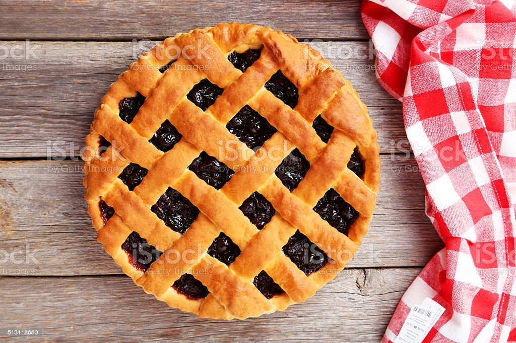 Homemade pie on grey wooden background stock photo