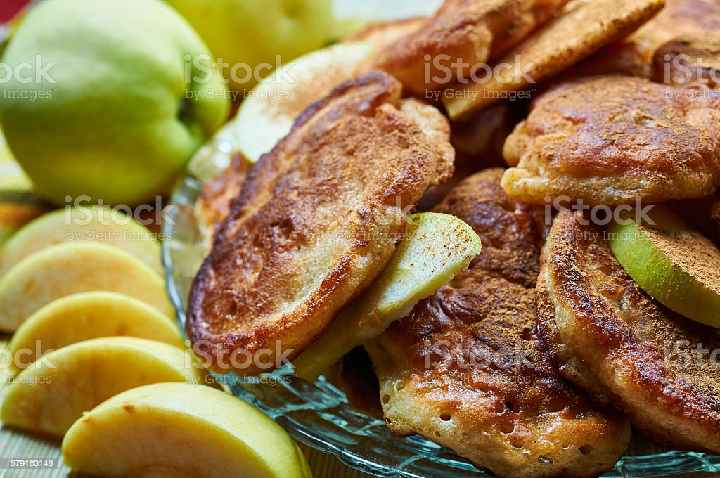 Homemade pikelets with apples and cinamon stock photo