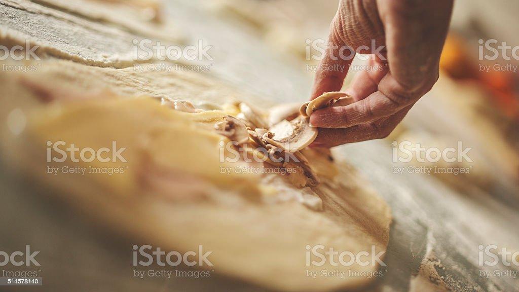 Homemade pizza before baking stock photo