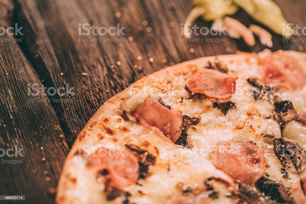 Homemade Pizza with ham and mushrooms stock photo