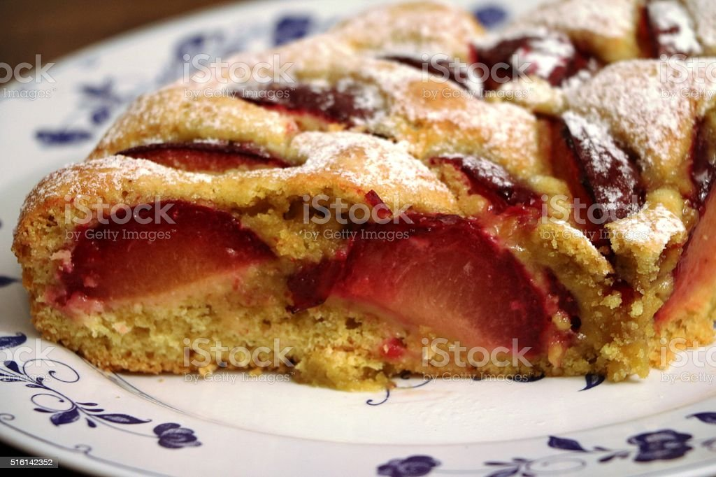 Homemade plum cake with comminuted sunflower seeds stock photo