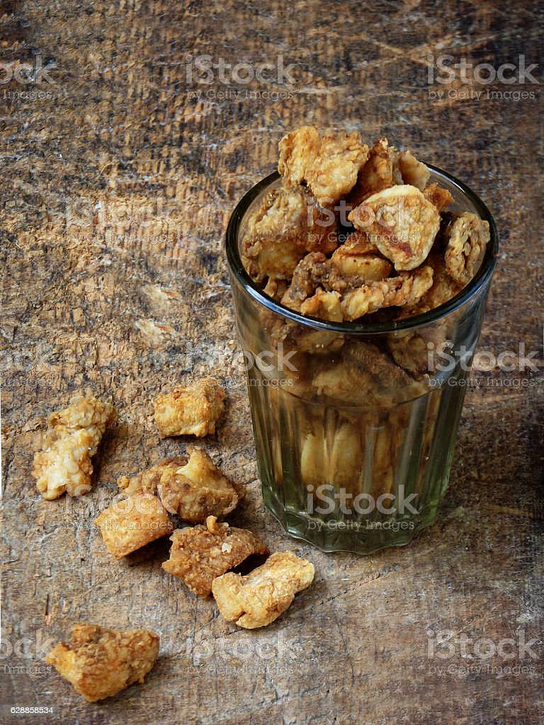 Homemade pork crackling / scratchings  in glass stock photo