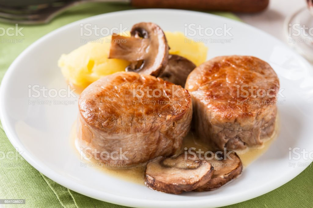 Homemade pork loin fillet with mashed potatoes stock photo