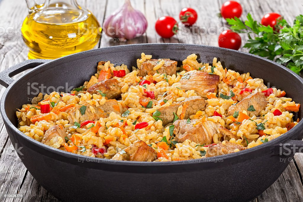 Homemade prepared paella with meat, pepper, vegetables and spice stock photo