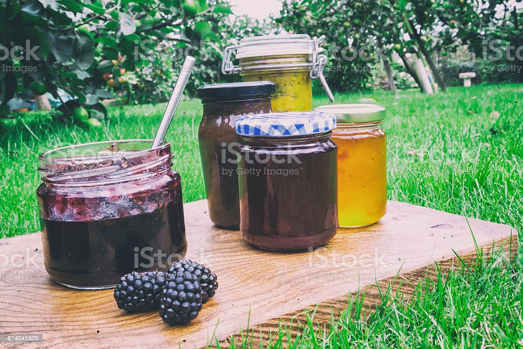 Homemade preserves, jams and chutneys  in the apple orchard stock photo