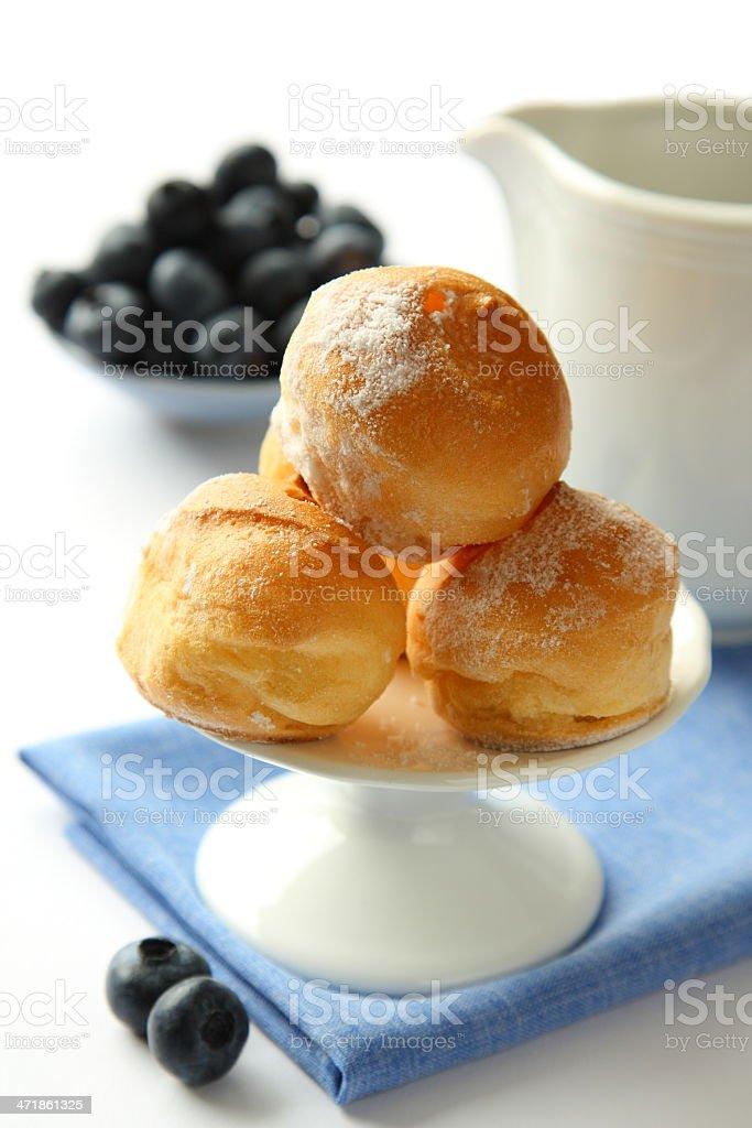 Homemade profiteroles with cream, selective focus royalty-free stock photo