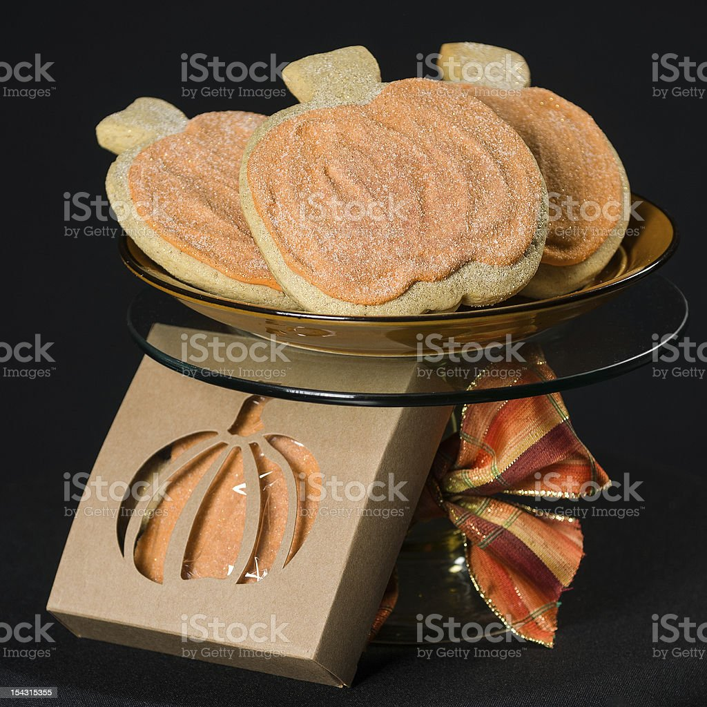 Homemade pumkin cookies on isolated black royalty-free stock photo