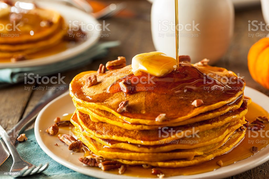 Homemade Pumpkin Pancakes with Butter stock photo