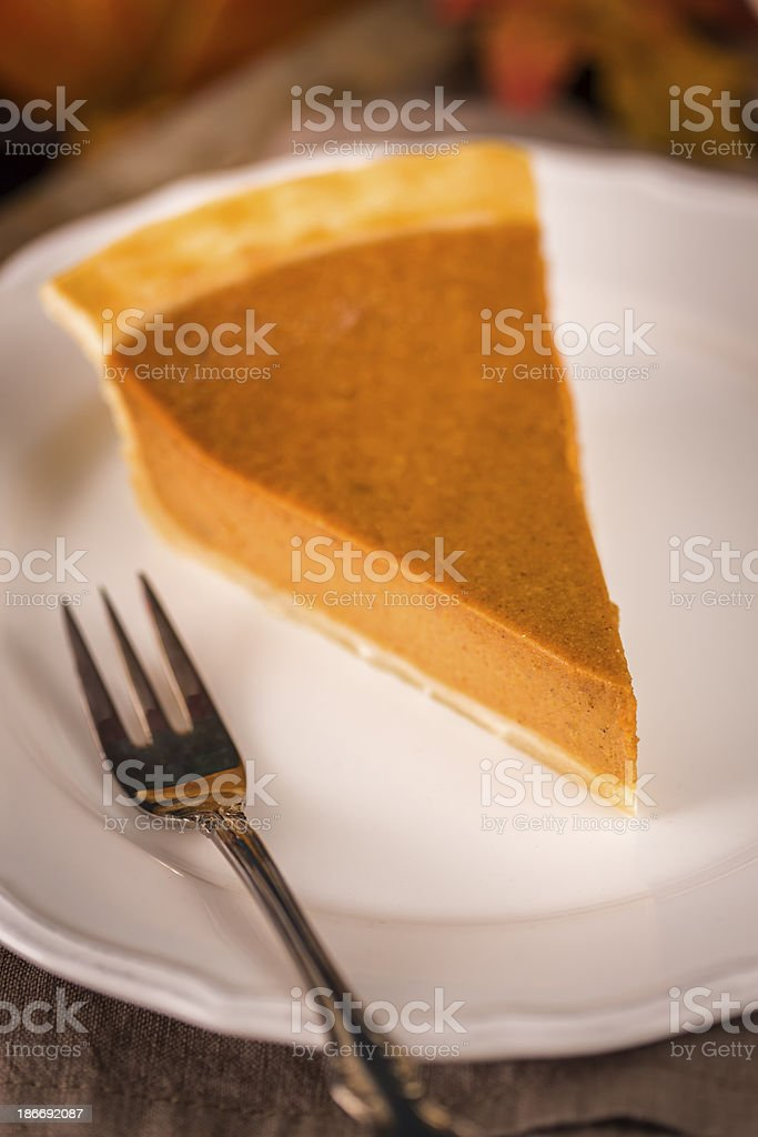 Homemade Pumpkin Pie Served on a Plate royalty-free stock photo