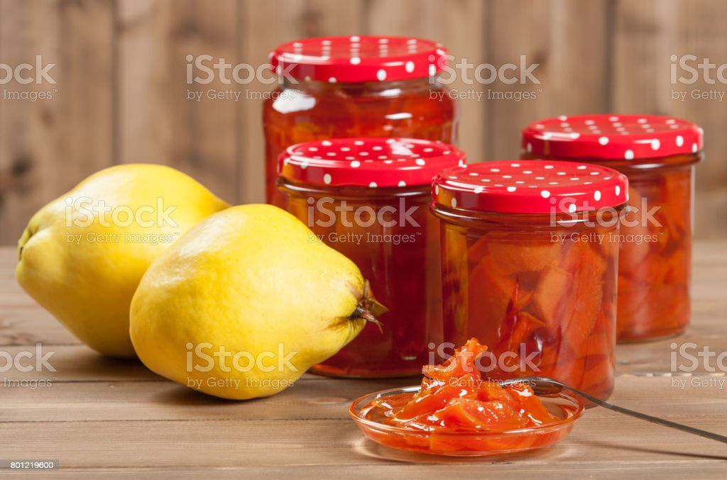Homemade Quince Jam Preserve. Ripe Quince Fruits. stock photo
