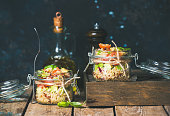 Homemade quinoa salad with cherry and sun-dried tomatoes, avocado