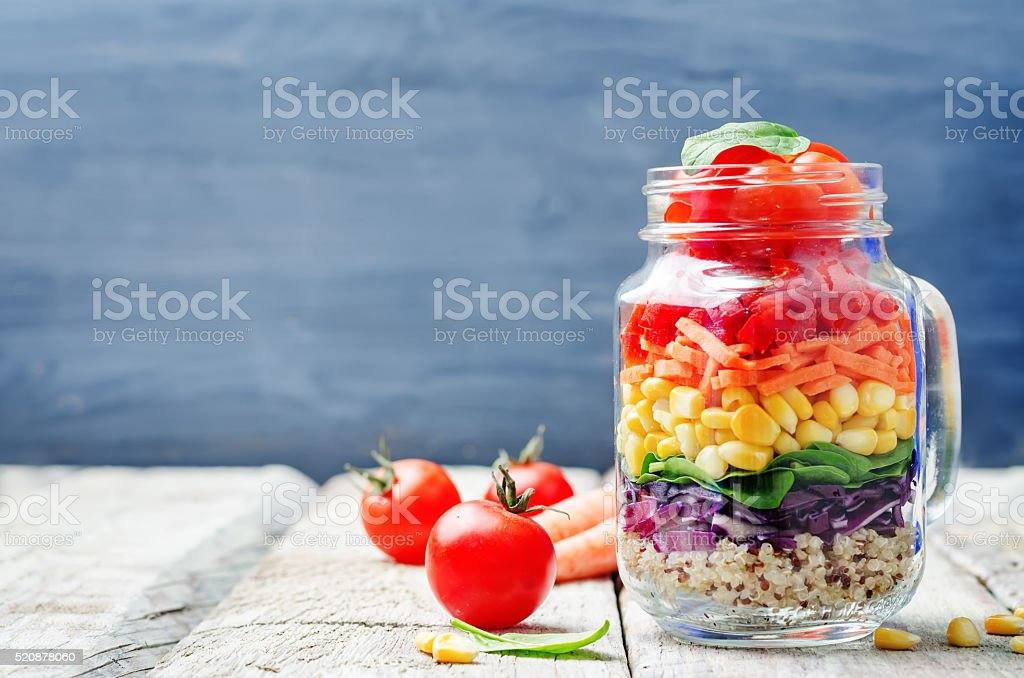 homemade rainbow salad with vegetables and quinoa stock photo