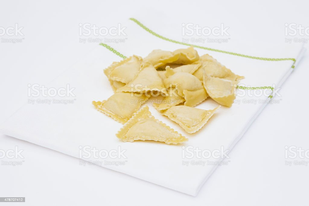 Homemade ravioli on white kitchen towel stock photo