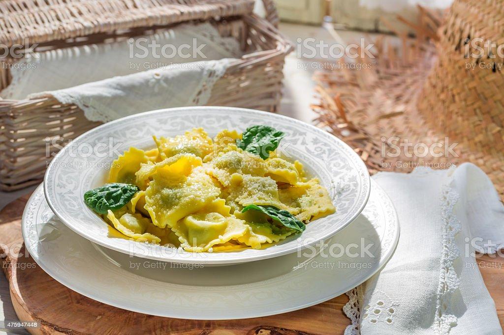 Homemade ravioli with parmesan stock photo