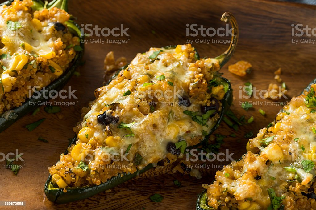 Homemade Roasted Quinoa Stuffed Poblano Peppers stock photo
