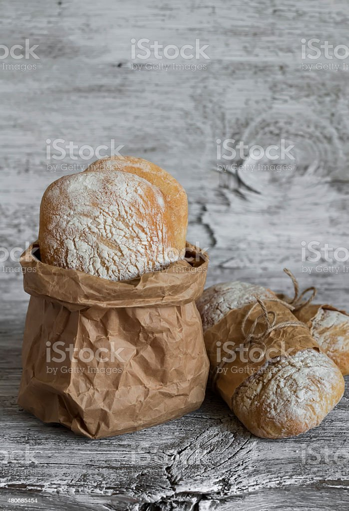 homemade rustic bread on a light wooden surface stock photo