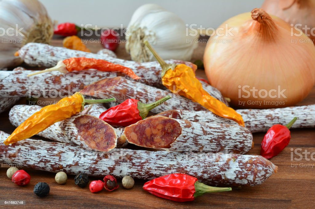 Homemade salametti  with spices and vegetables stock photo