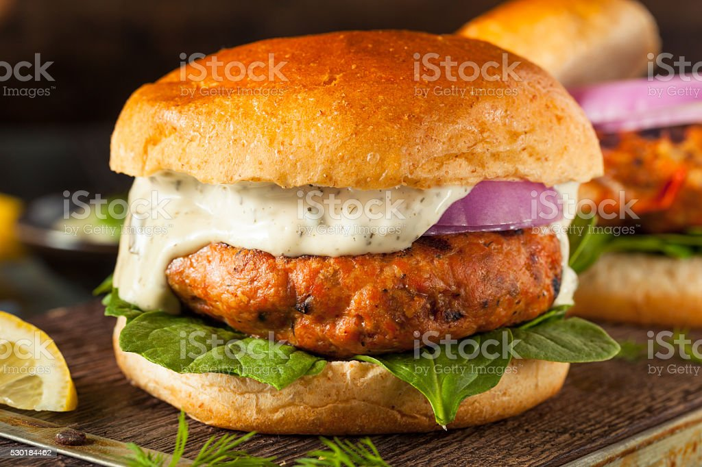 Homemade Salmon Burger with Tartar Sauce stock photo