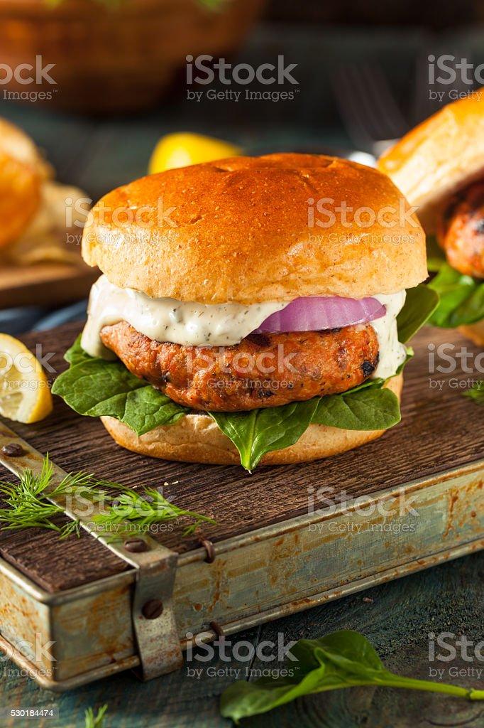 Homemade Salmon Burger with Tartar Sauce stock photo