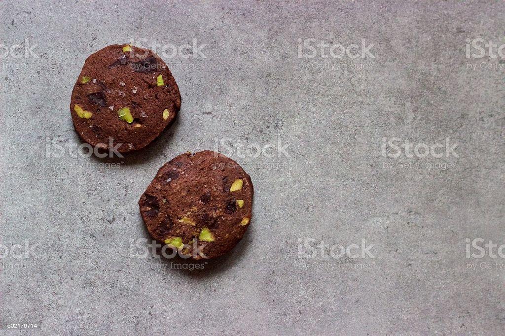 Homemade salted chocolate pistachio icebox, slice-and-bake Christmas cookies stock photo