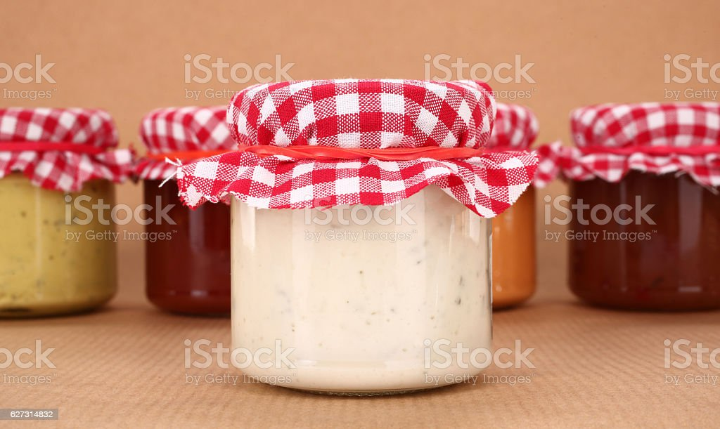 Homemade sauces in jars stock photo