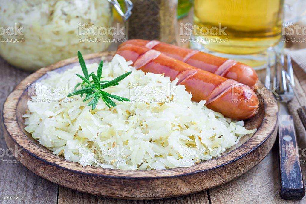 Homemade sauerkraut with sausages stock photo