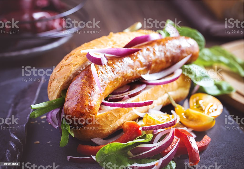 Homemade sausage with bun and vegetables stock photo