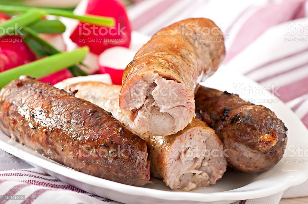Homemade sausages baked in the oven and salad stock photo