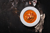 Homemade seafood soup with tomato sauce and coconut milk