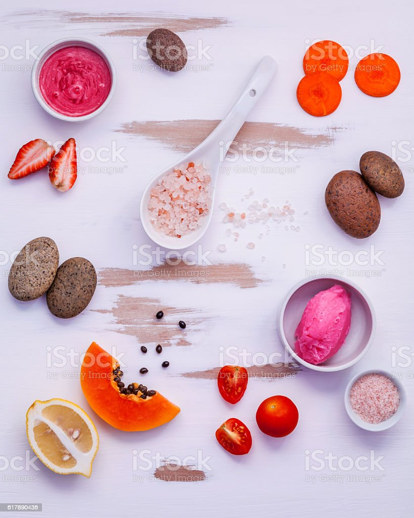Homemade skin care and body scrubs with red natural ingredients stock photo