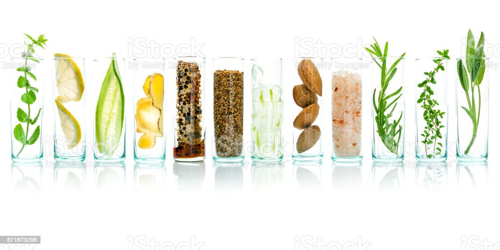 Homemade skin care with natural ingredients aloe vera, lemon, cucumber, himalayan salt, peppermint, rosemary, almonds, cucumber, ginger and honey pollen isolated on white background. stock photo