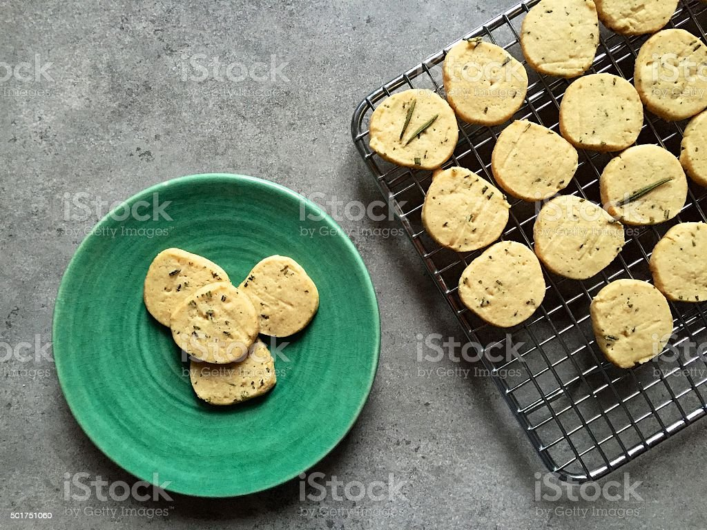 Homemade slice and bake rosemary butter cookies on cooling rack stock photo
