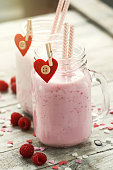 Homemade smoothie with raspberry in jars. Love, eating concept