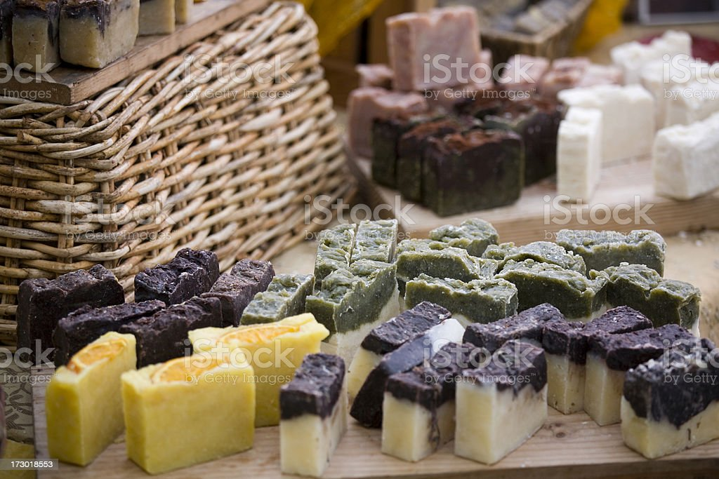 homemade soaps adjacent to a woven basket. royalty-free stock photo