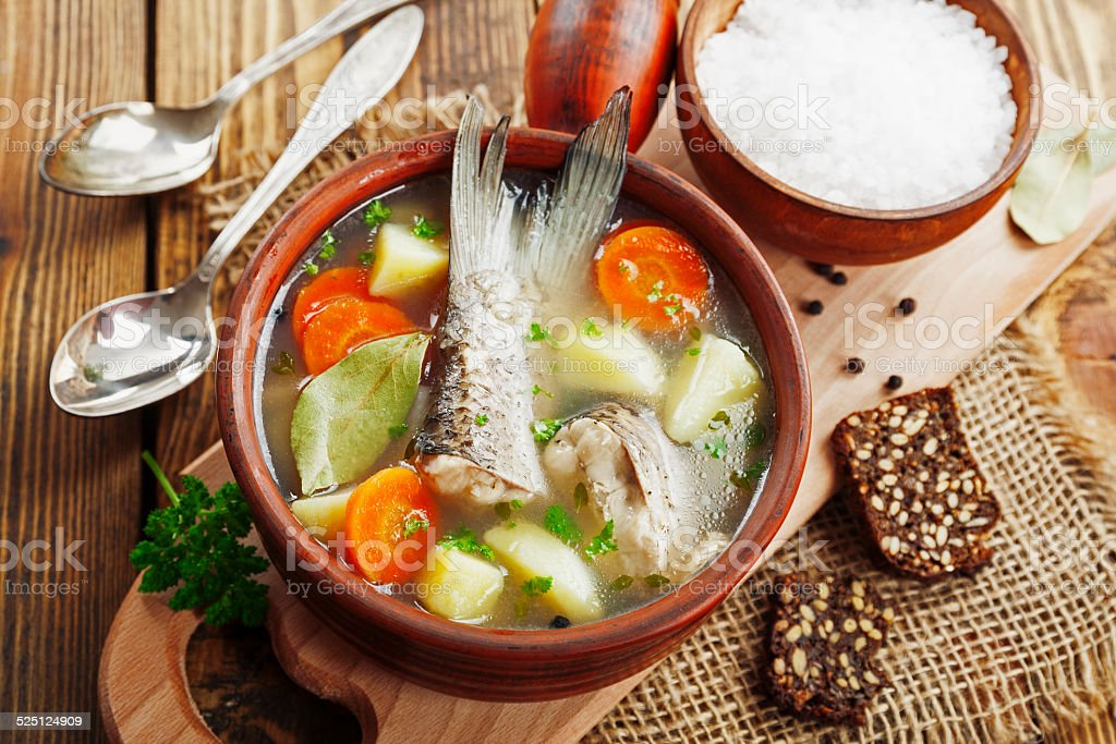 Homemade soup of river fish in the bowl stock photo