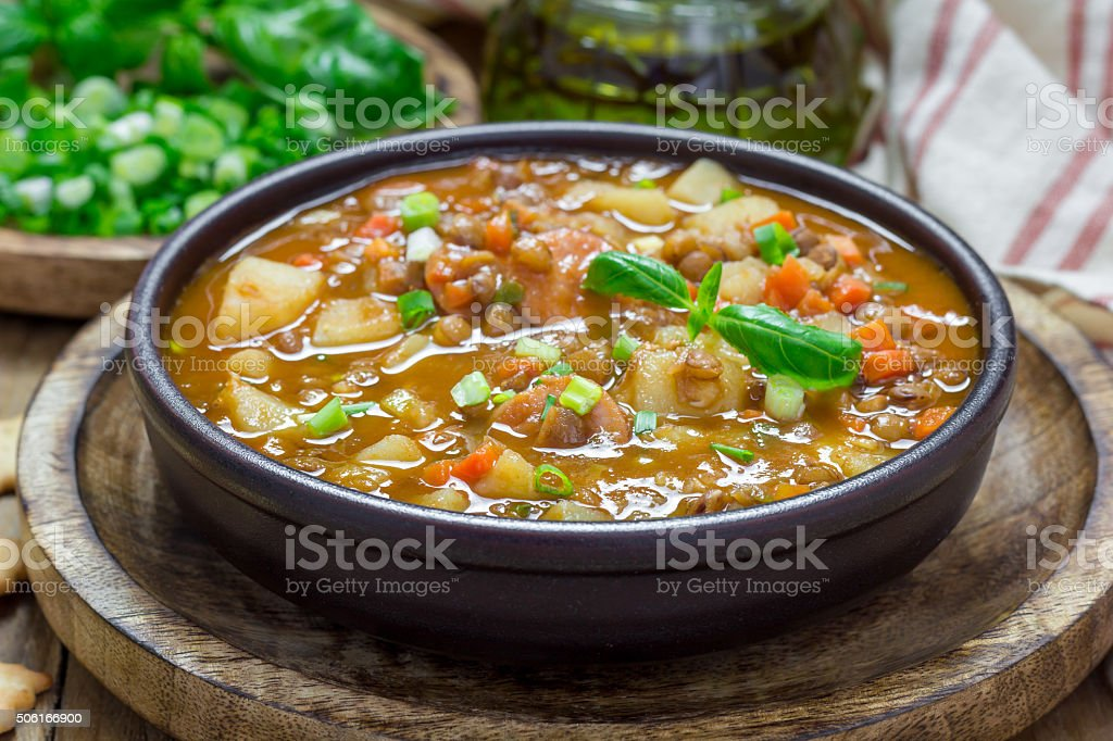 Homemade soup with lentils and sausages stock photo