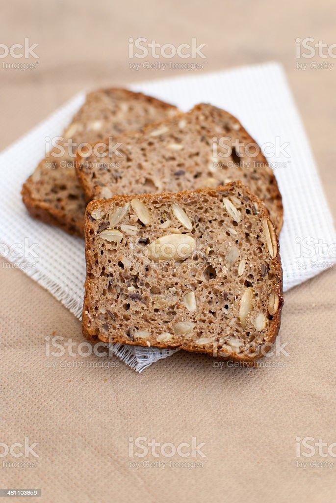 Homemade sourdough rye bread with flax seed, sunflower seeds, pumpkin seeds stock photo