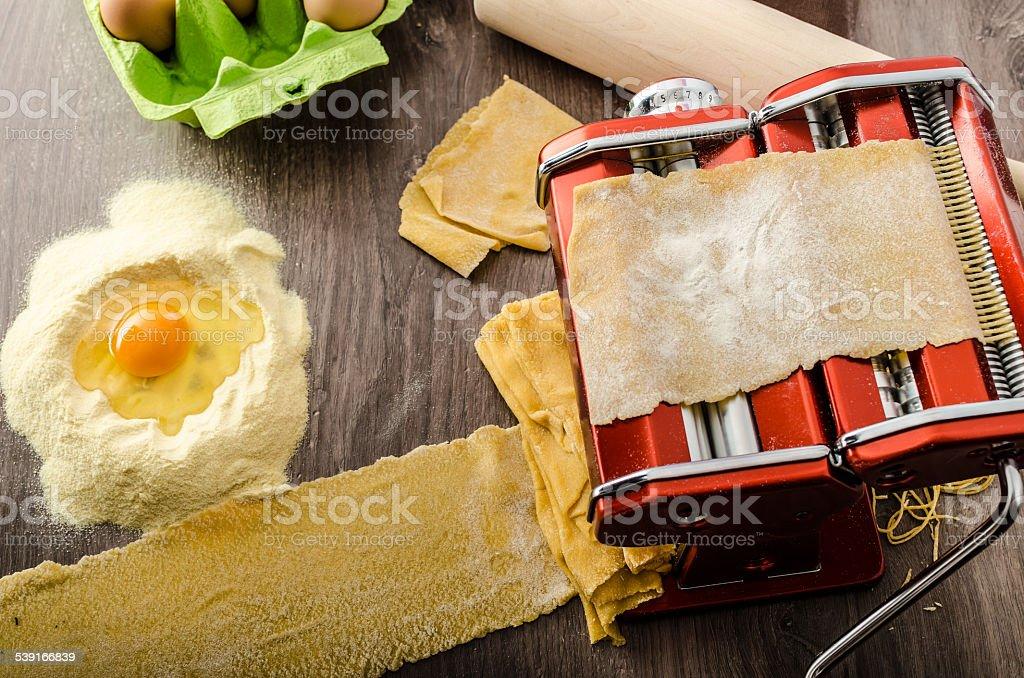 Homemade spaghetti carbonara production stock photo