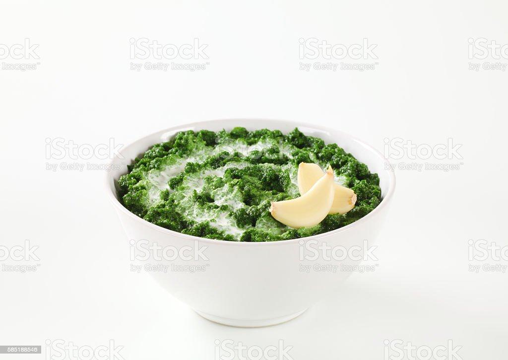 homemade spinach puree stock photo