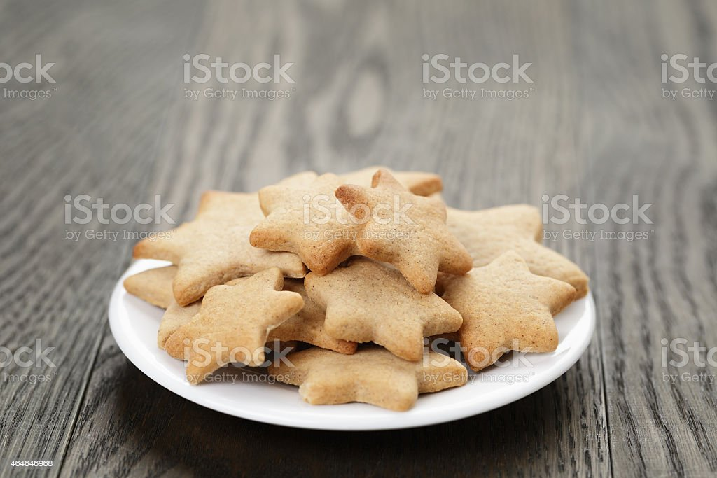 homemade star shape ginger cookies on wood table stock photo