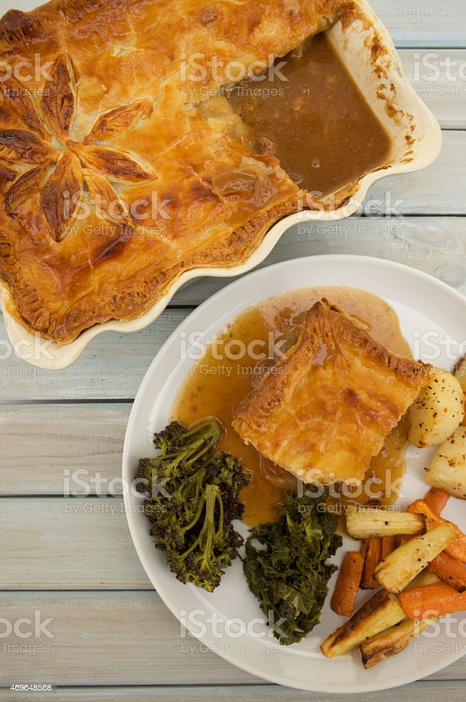 Homemade Steak and Ale Pie with Puff Pastry stock photo