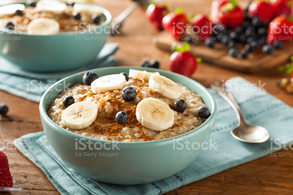 Homemade steel cut bowl of oatmeal in blue bowl stock photo