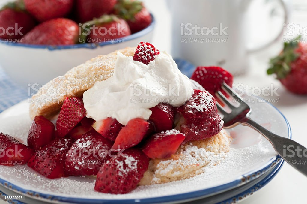 Homemade strawberry shortcake with powdered sugar stock photo