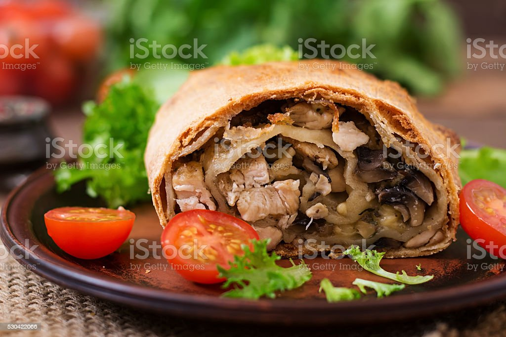 Homemade strudel with chicken, mushrooms, cheese and parsley stock photo