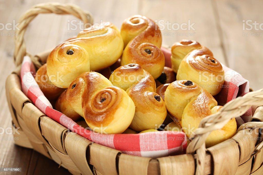 homemade swedish saffron buns, lussekatt in basket stock photo